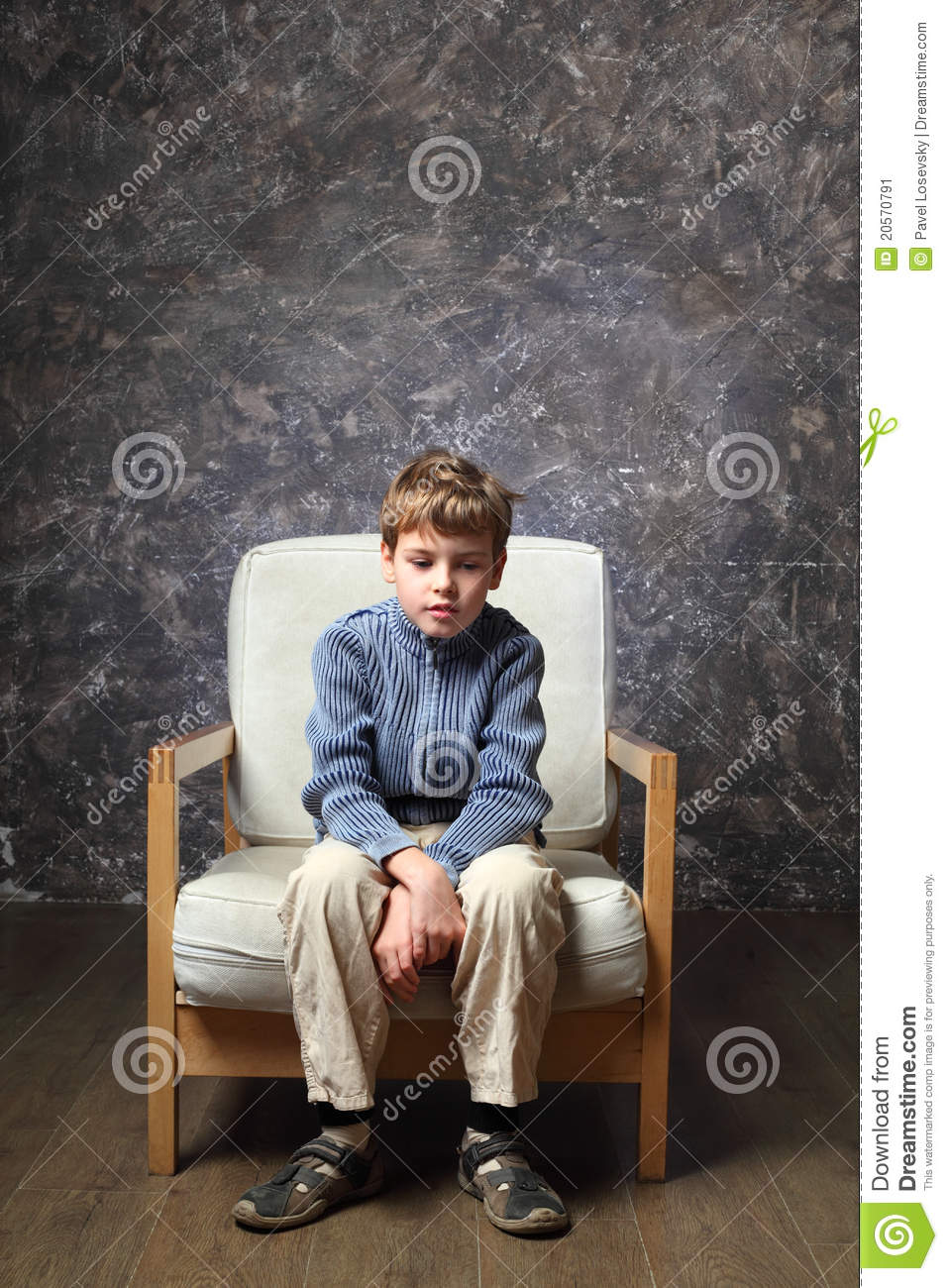 Little Boy Sitting On Chair In Studio Stock Image Image