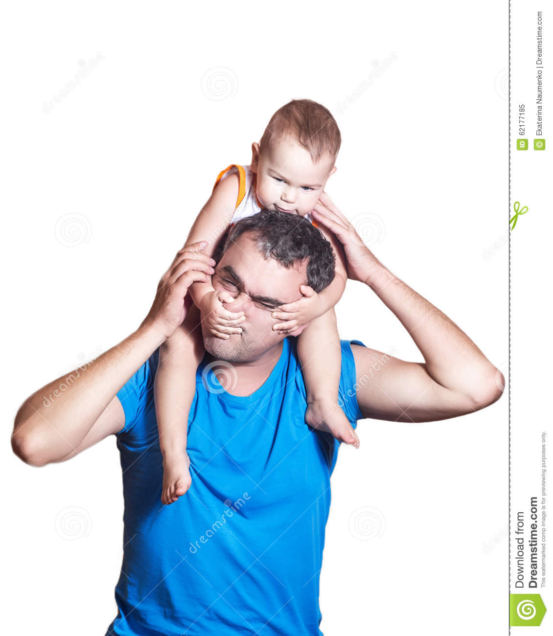 Little boy sitting on dad s shoulders, they play a fun game