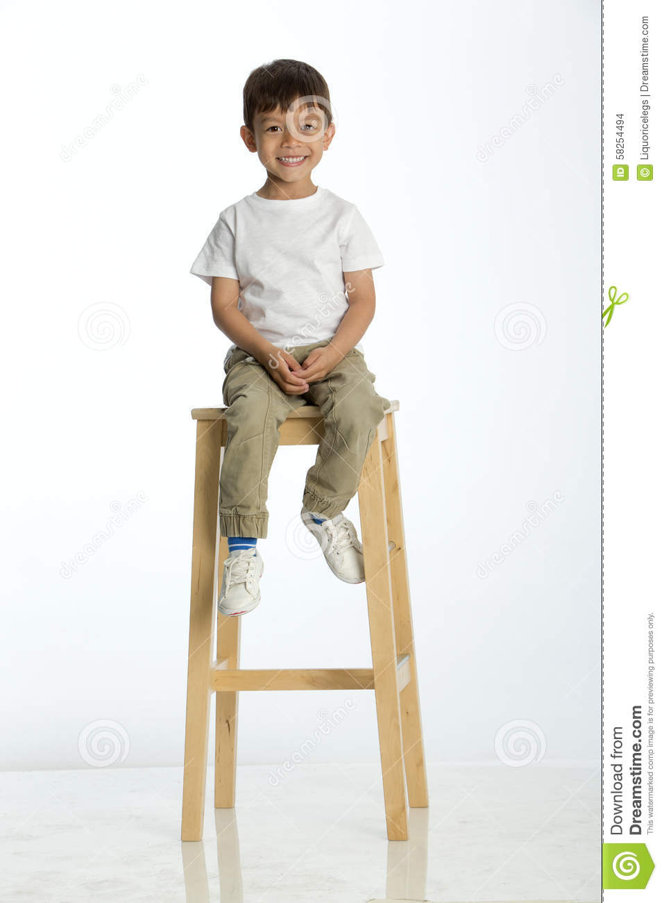 Little Boy Sitting On A High Stool Stock Photo Image