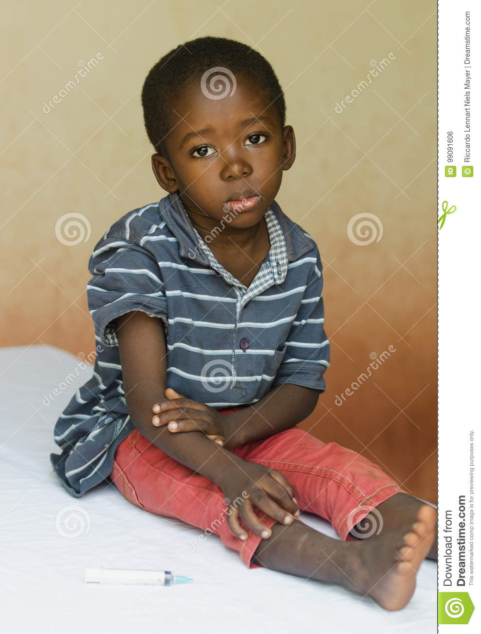 Little boy sitting in a hospital waiting to get an injection
