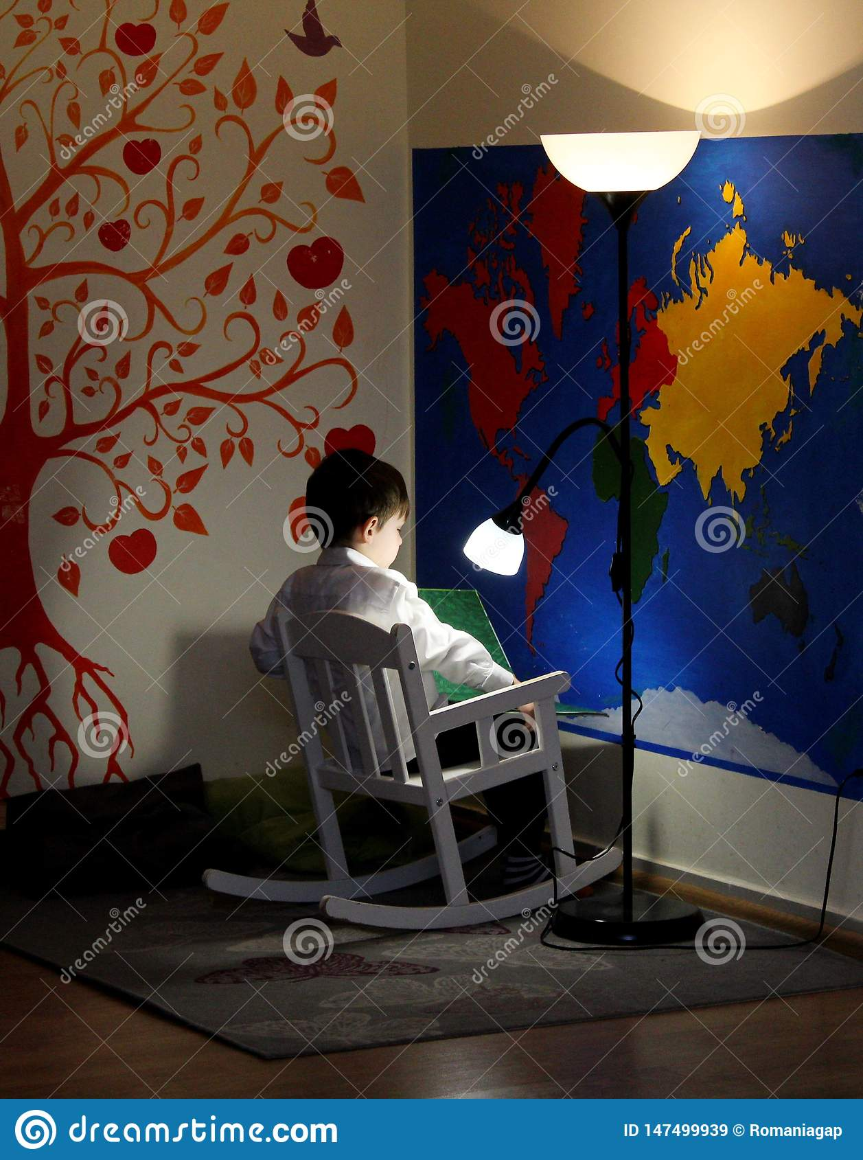 Phenomenal A Little Boy Sitting In A Rocking Chair Reads And A Lamp Pdpeps Interior Chair Design Pdpepsorg