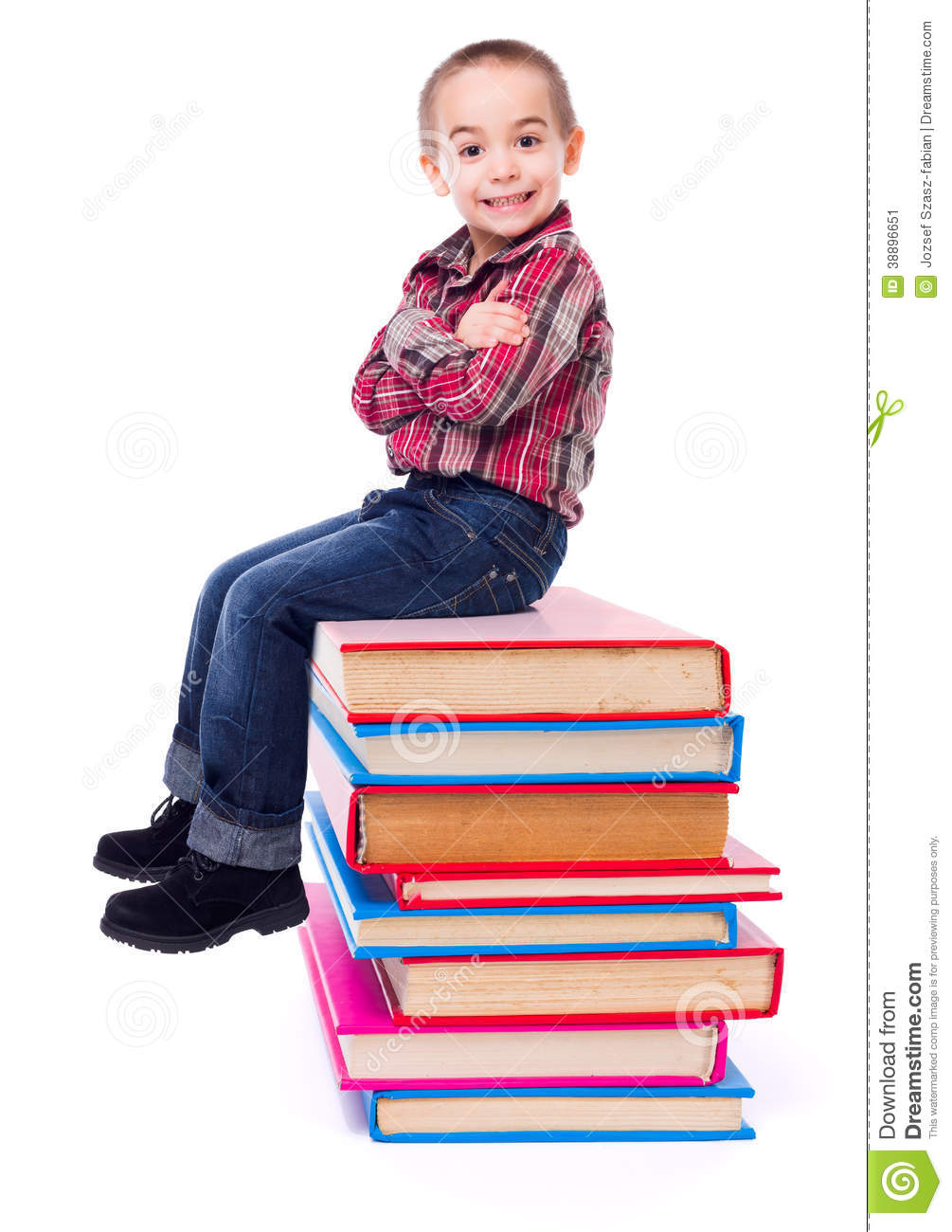 Little Boy Sitting On Stacked Colorful Books Stock Image