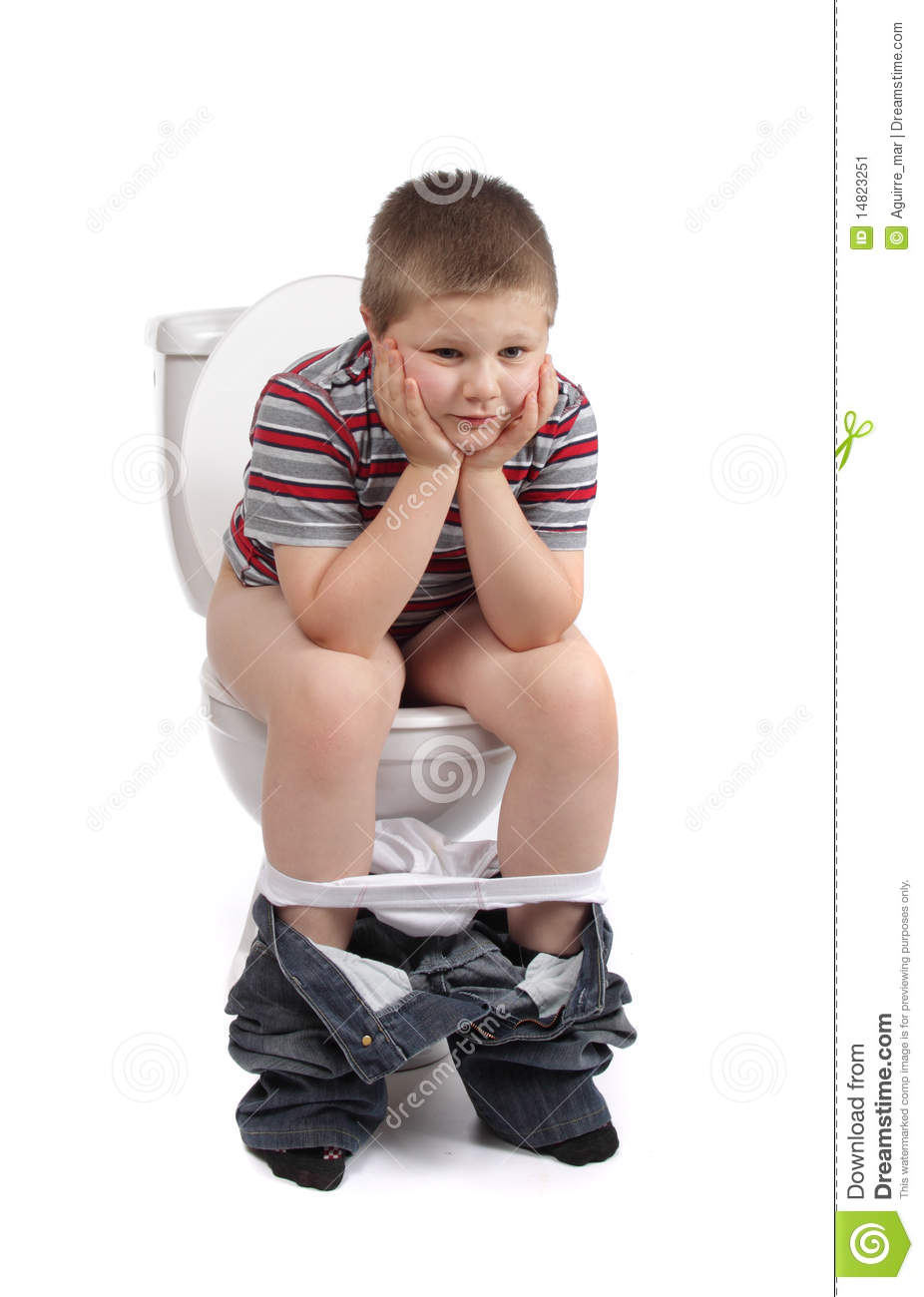young boy and the toilets Little boy is sitting on toilet