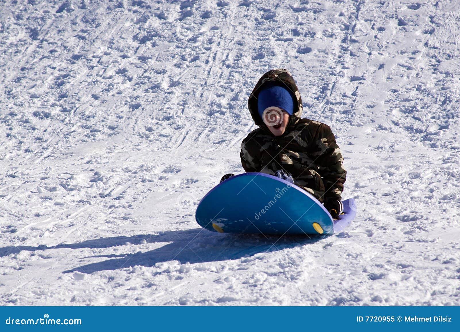 Little Boy Sledding Down The Hill Royalty Free Stock Photo