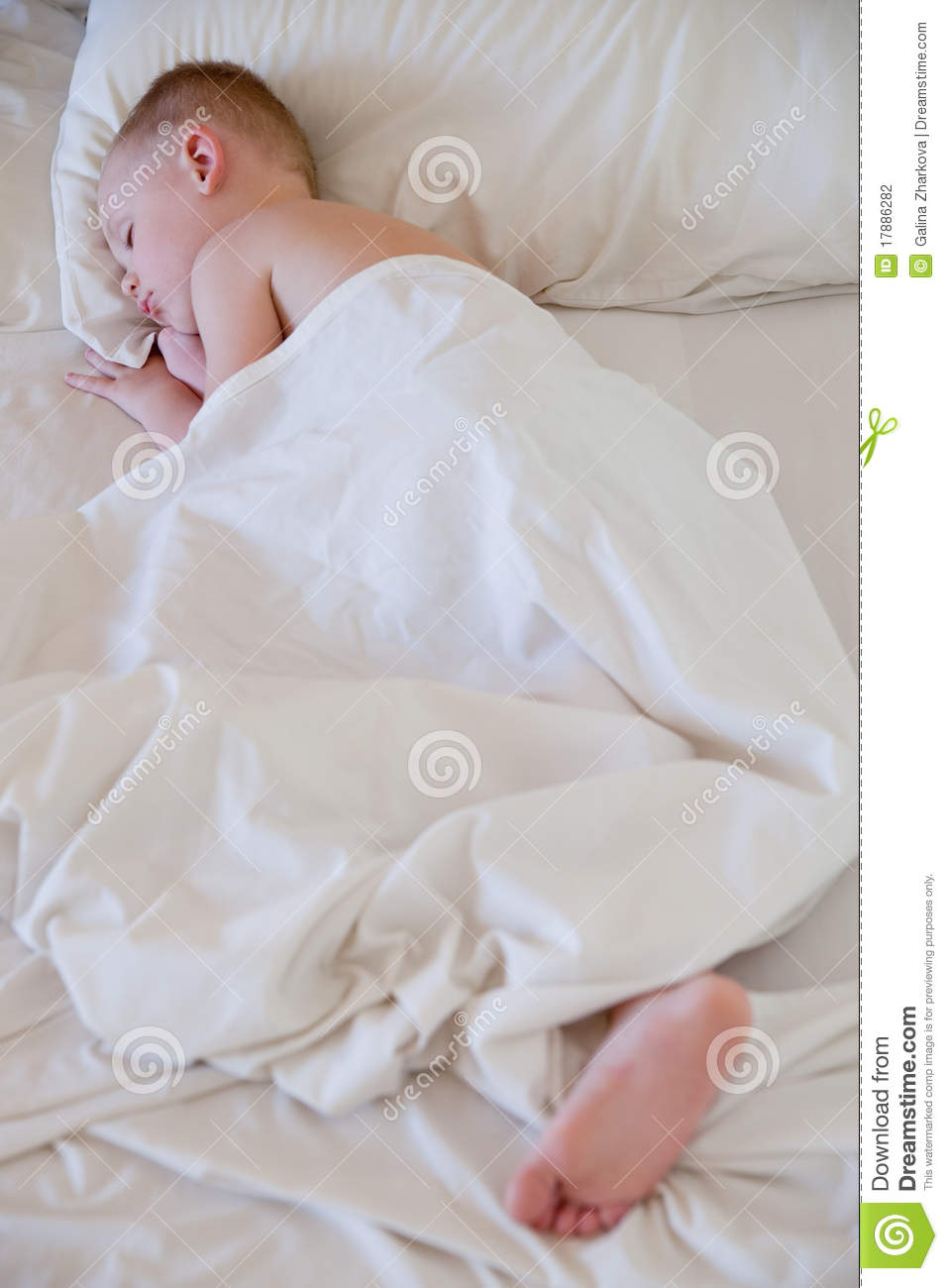 Little Boy Sleep On White Bed Stock Photography