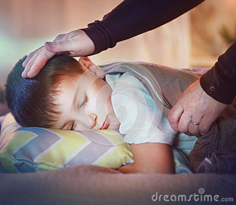 Download Little Boy Sleeping And Dreaming In His Bed Stock Image