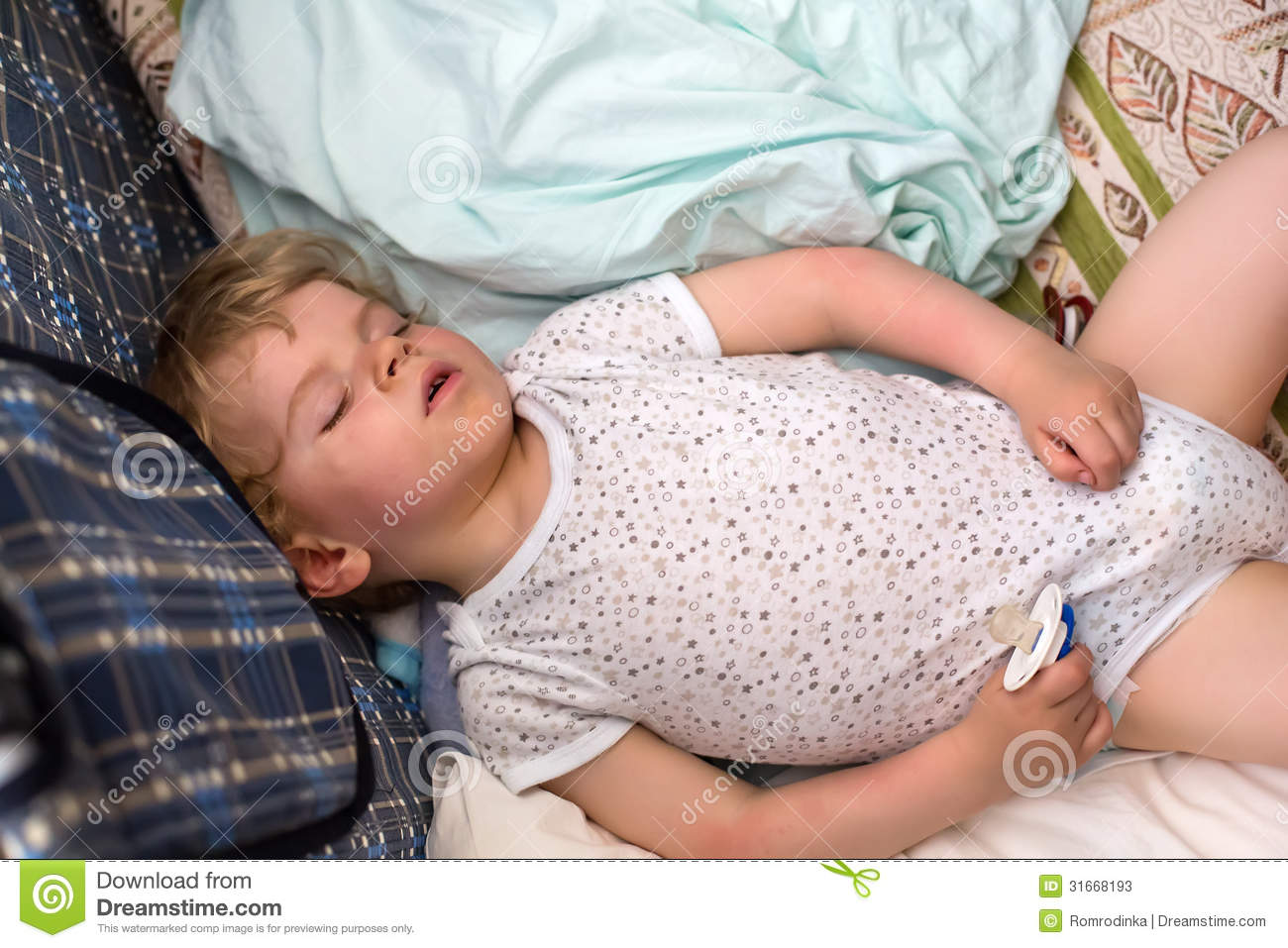 Little Boy Sleeping In His Bed Stock Photos - Image: 31668193