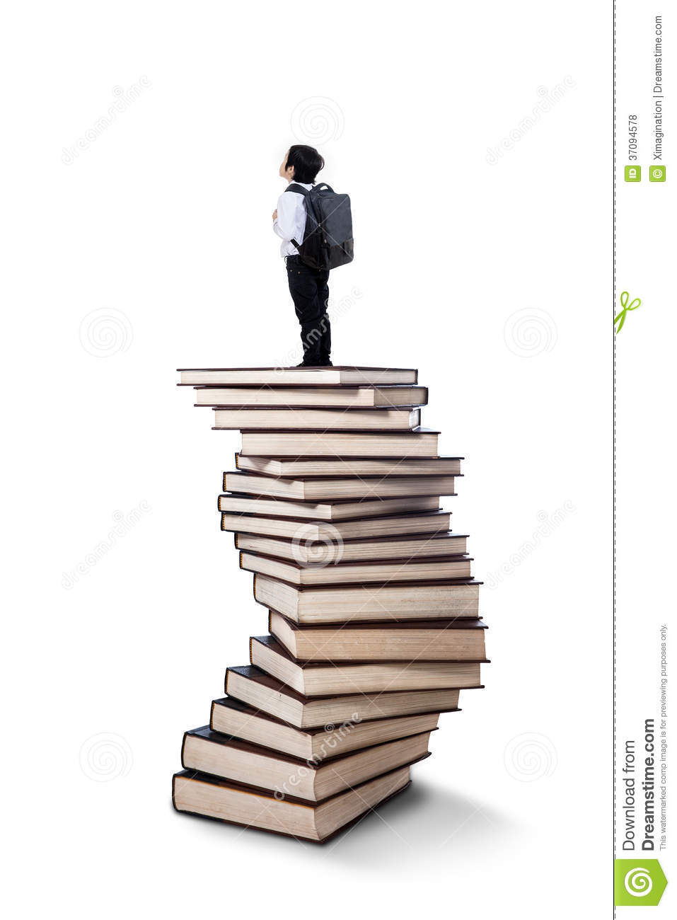 little boy standing on books stack royalty free stock