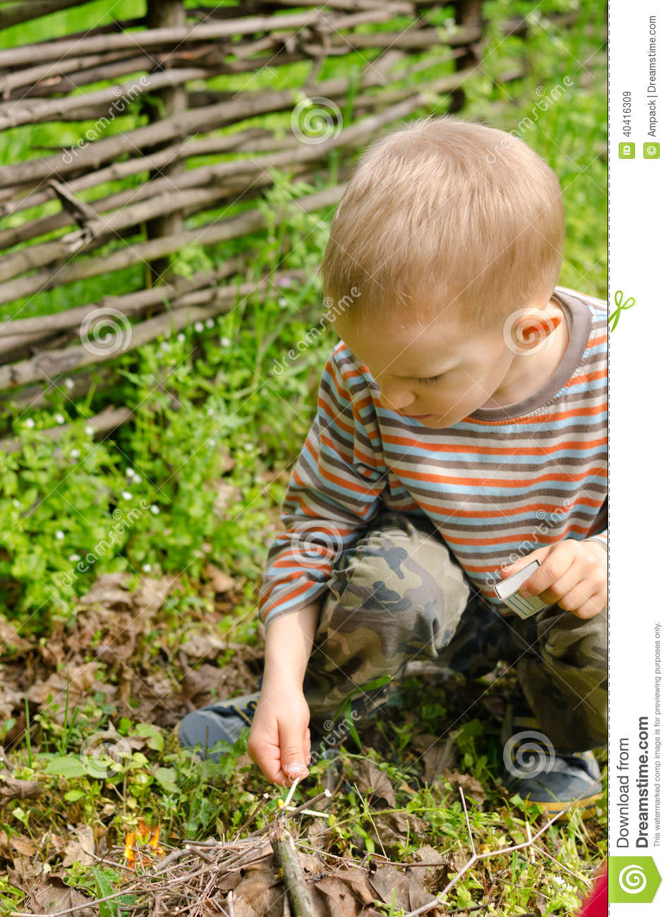 Download comp & Little Boy Starting A Campfire Stock Image - Image of lighting ...