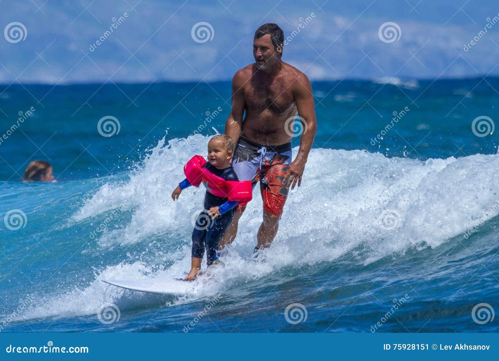 Little boy surfing on Maui.
