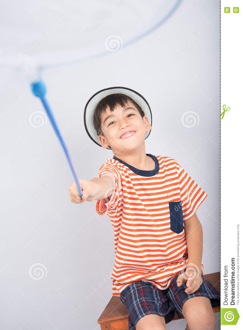 Little boy taking insect net outdoor activities on white background