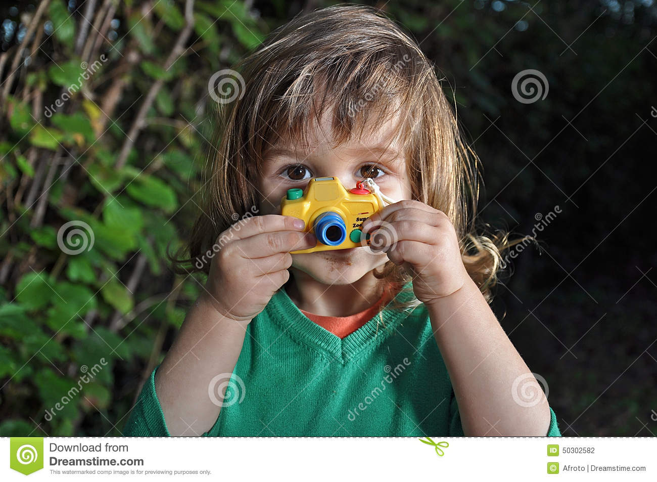 Little boy with toy camera