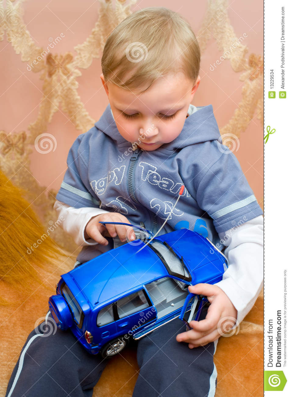 Little Boy With Toy Car : Little boy with toy car stock images image