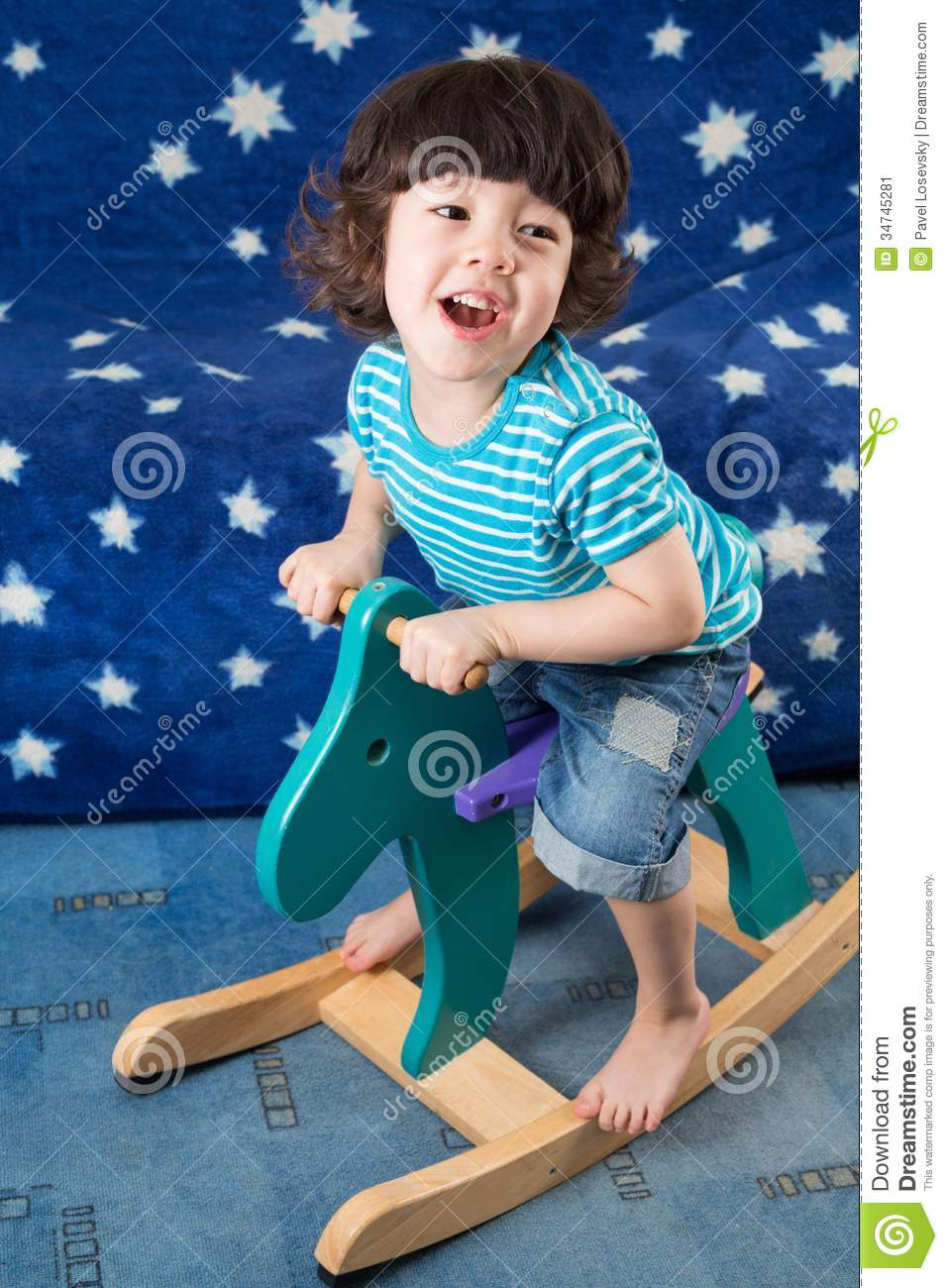 Download Little Boy On A Toy Horse In A Room Stock Image - Image of asterisk, play: 34745281