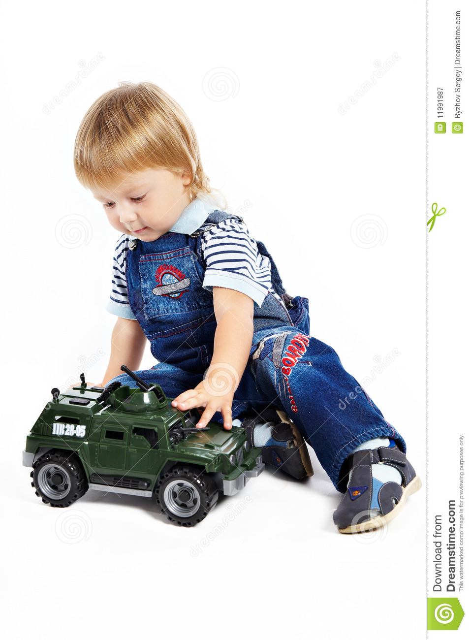 Little Boys Toys Border : The little boy with a toy military vehicle stock image