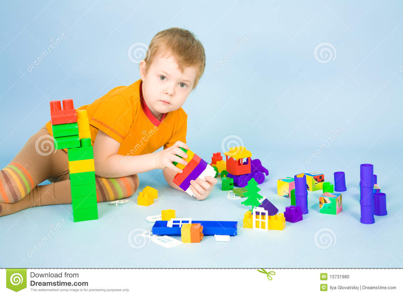 Little Boy Toys : Little boy with toys stock photo image