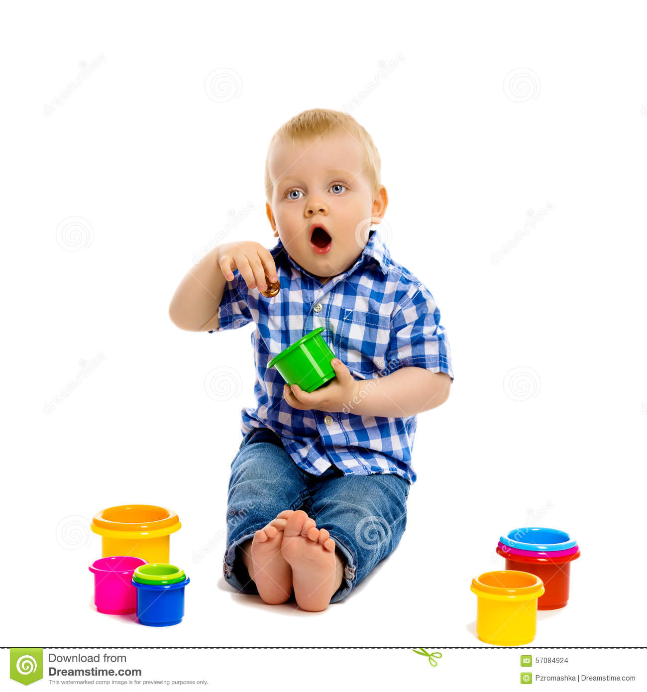 Boy Toys Background : Little boy with toys on a white background stock photo