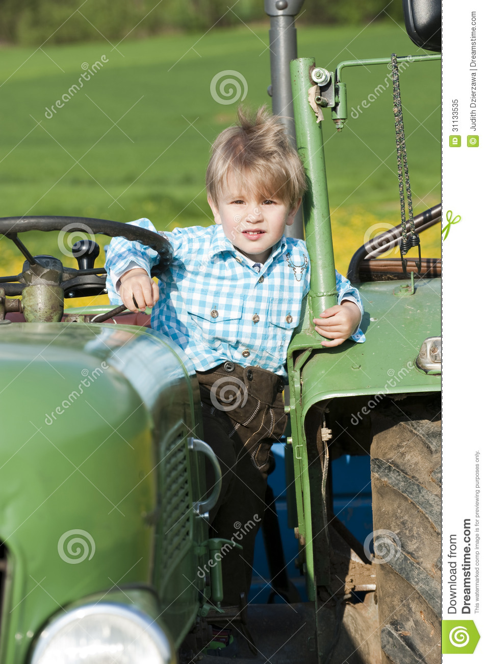 Boy On Tractor : Little boy on a tractor stock image of dandelion