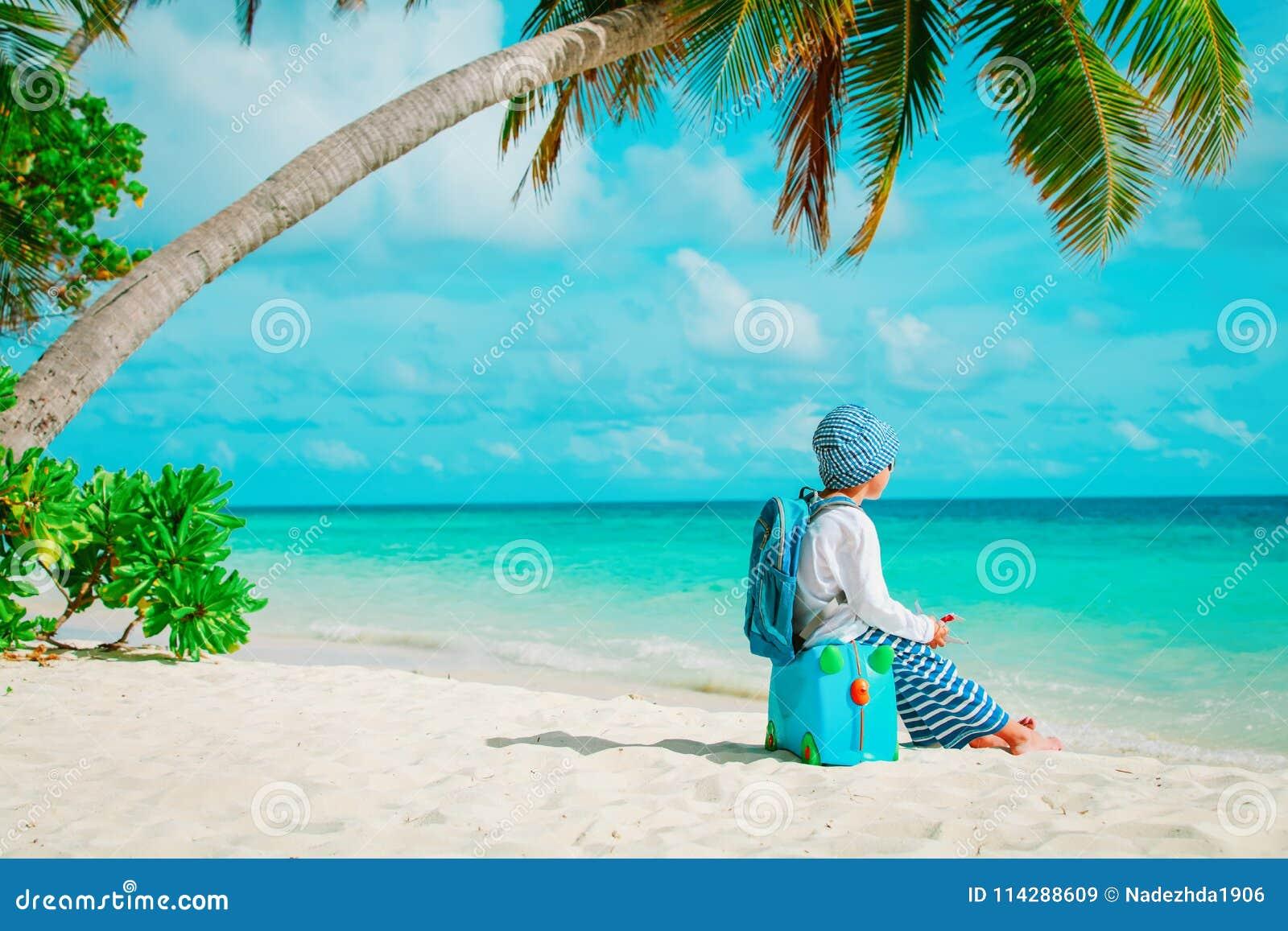 Little boy travel on tropical beach