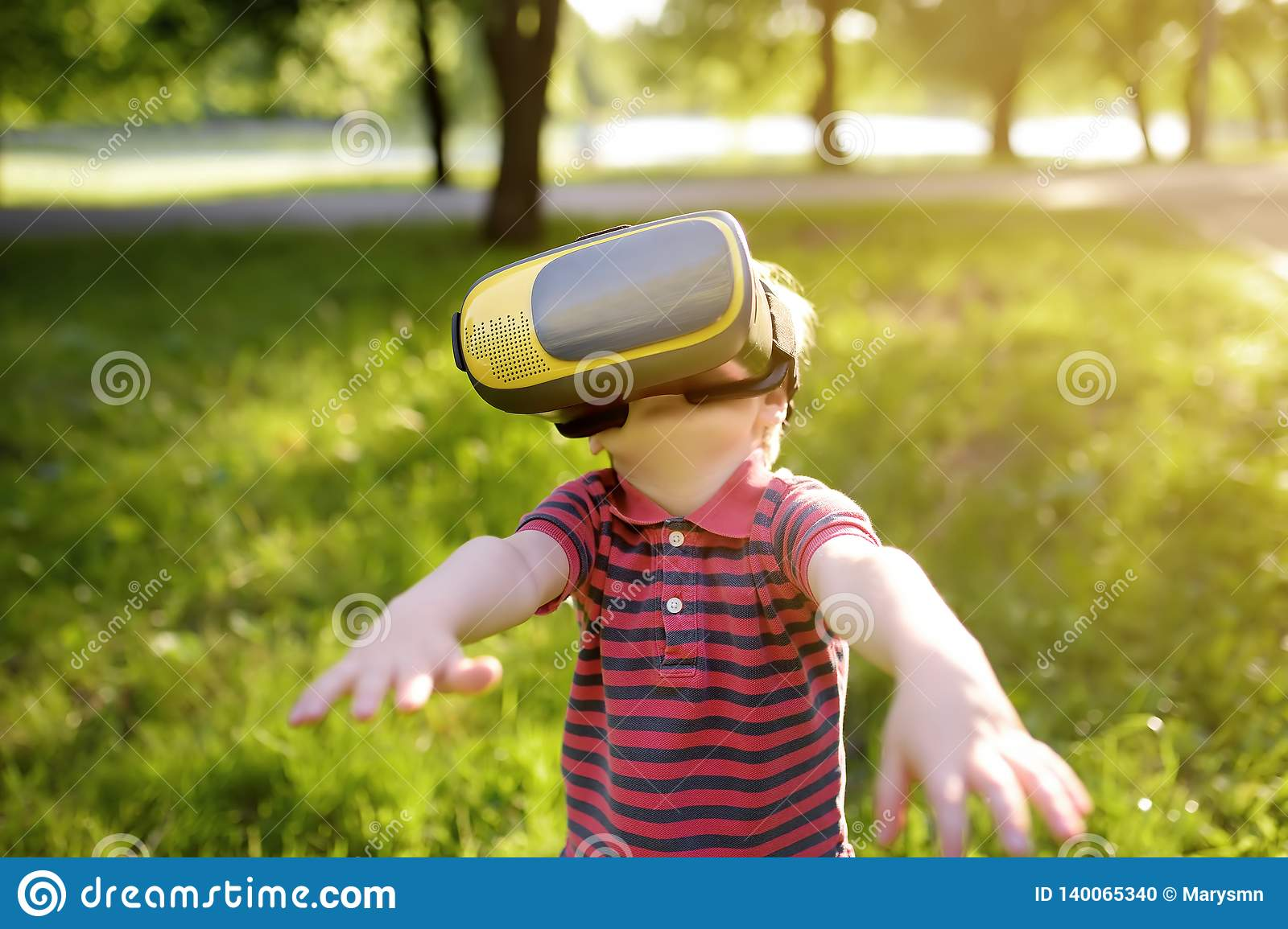 072703651c4 Little Boy Using Virtual Reality Headset Outdoor. VR