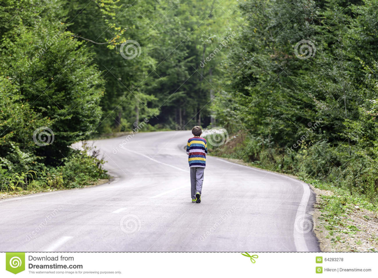 boy walking alone on road - photo #6