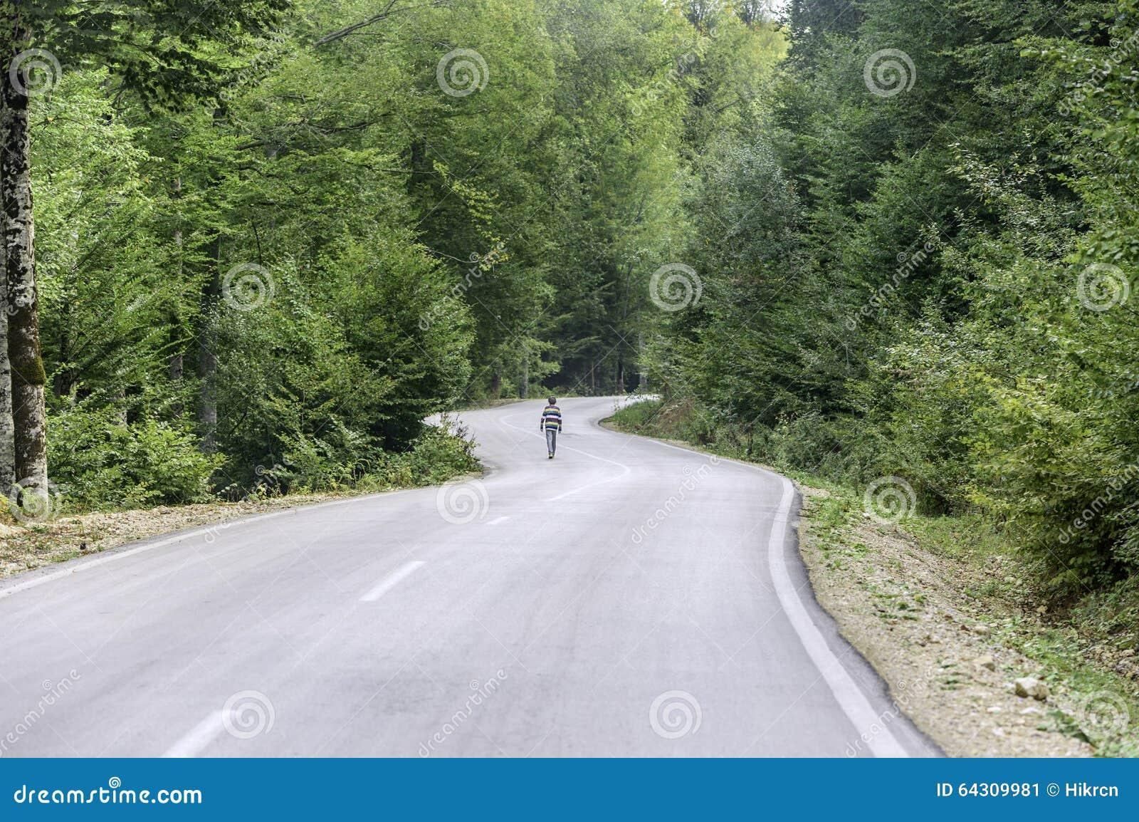 boy walking alone on road - photo #16