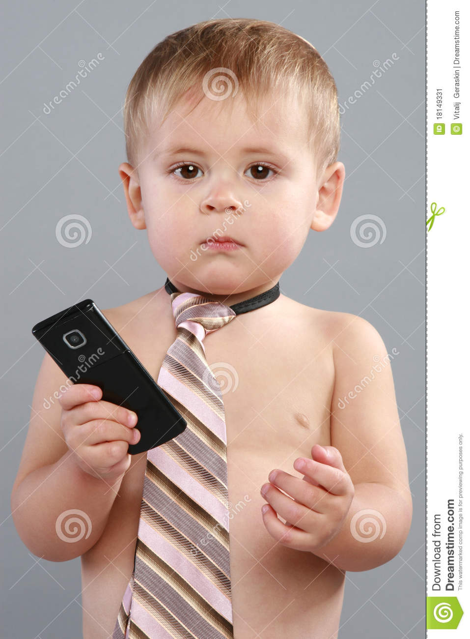 Little Boy Wearing A Tie And A Cellphone Stock Image