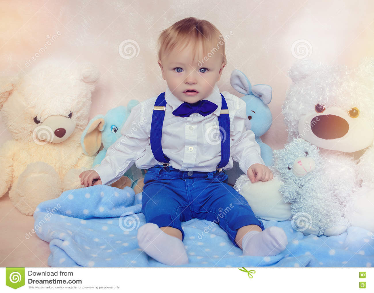 Little boy in a white shirt and bow tie stock photo for Baby boy blue shirt
