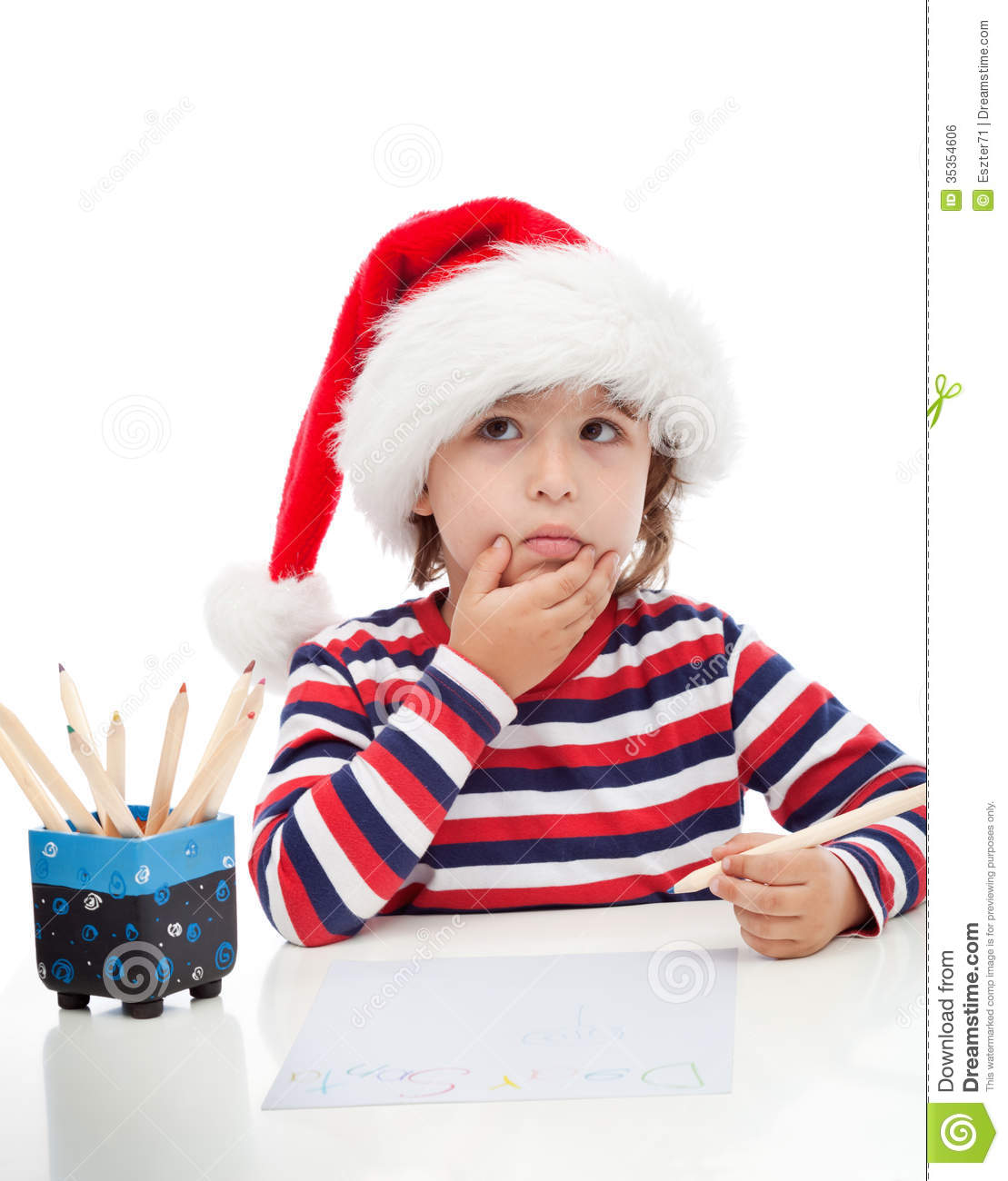 little boy writing a letter to santa