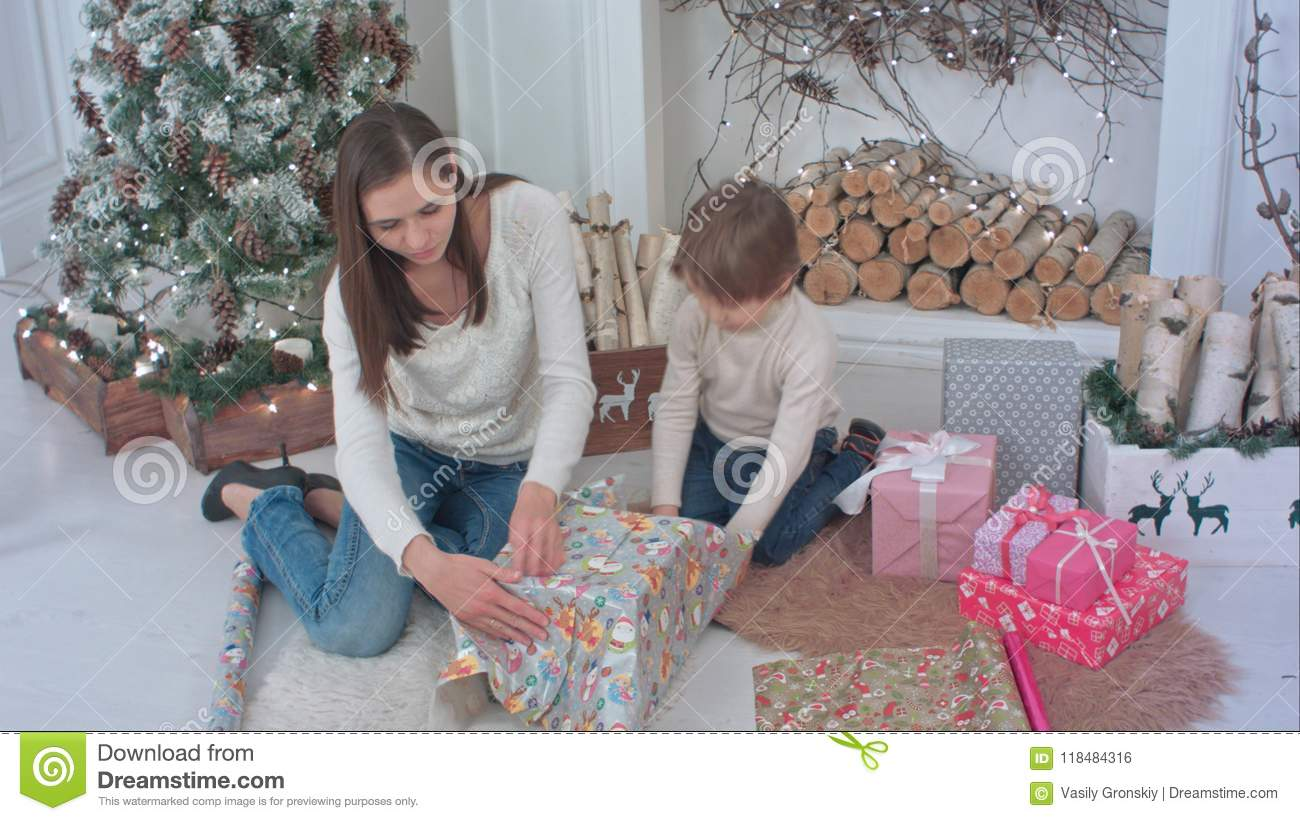 Little Boy And A Young Mother Preparing Christmas Presents Stock ...