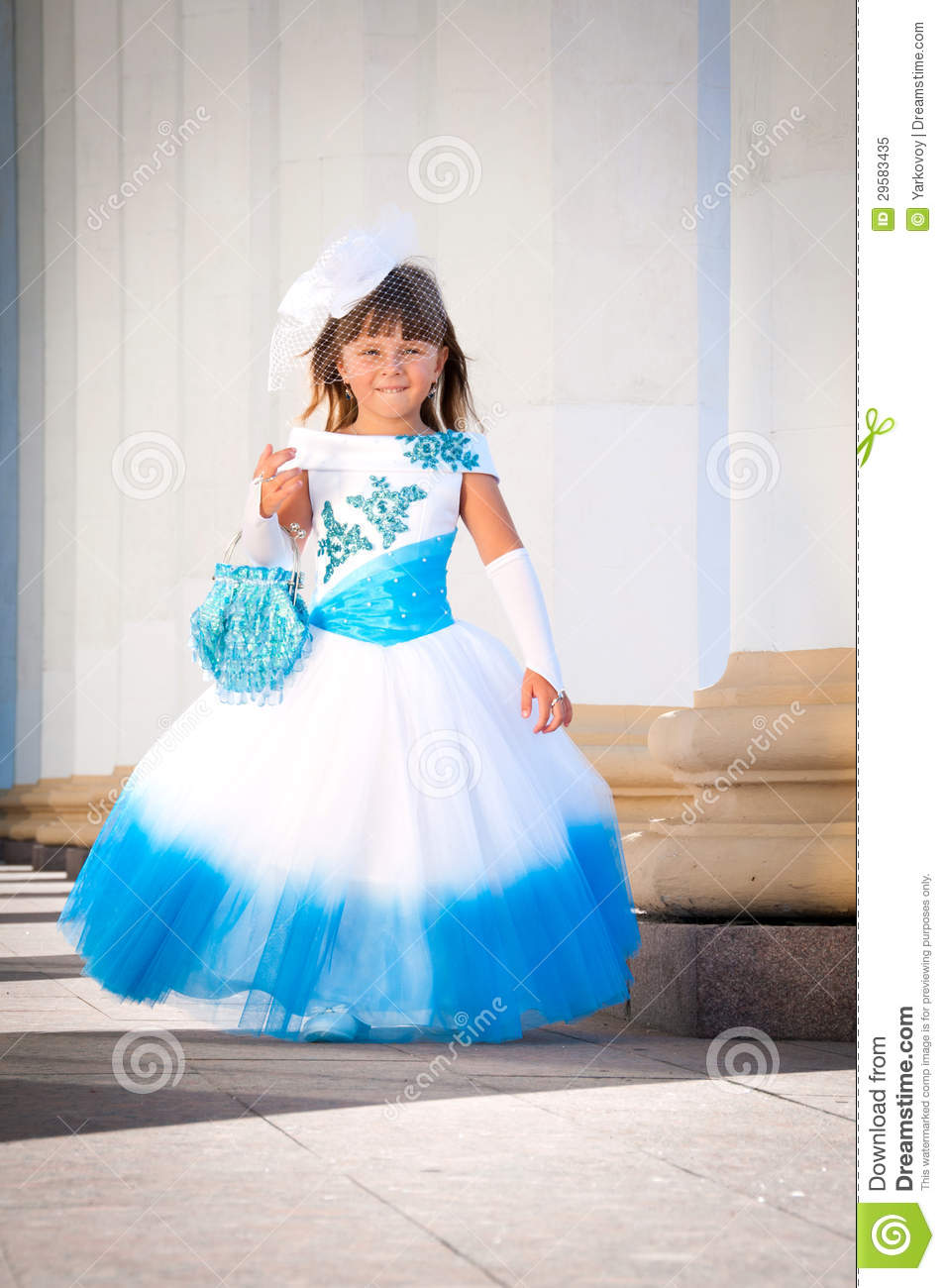 Little bride a girl in a lush white and blue wedding dress stock a girl in a lush white and blue wedding dress ombrellifo Image collections