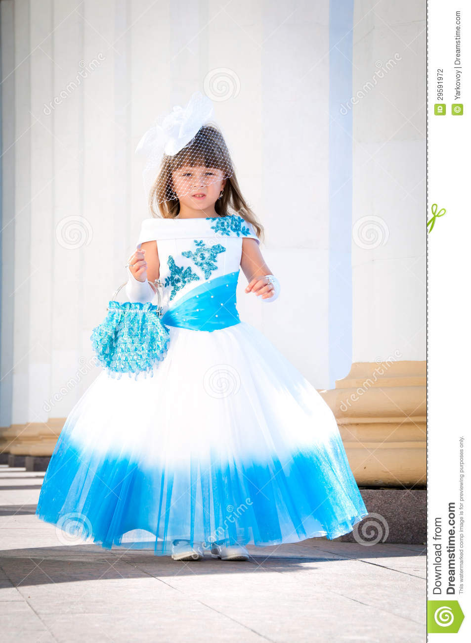 Little bride a girl in a lush white and blue wedding dress stock a girl in a lush white and blue wedding dress bridesmaid elegant ombrellifo Image collections
