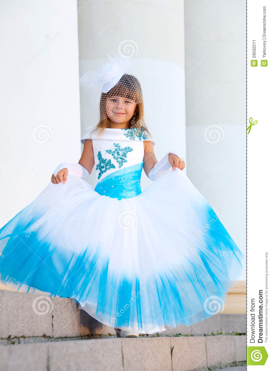 Little Bride. A Girl In A Lush White And Blue Wedding Dress Stock ...