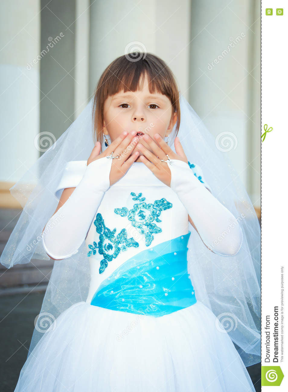 Little Bride. A Girl In A Lush White And Blue Wedding Dress And ...