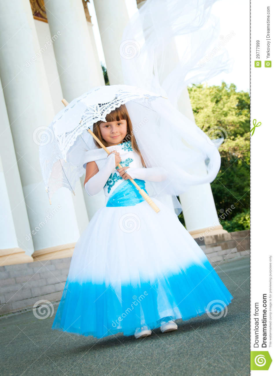 Little bride a girl in a lush white and blue wedding dress stock a girl in a lush white and blue wedding dress celebration female ombrellifo Image collections