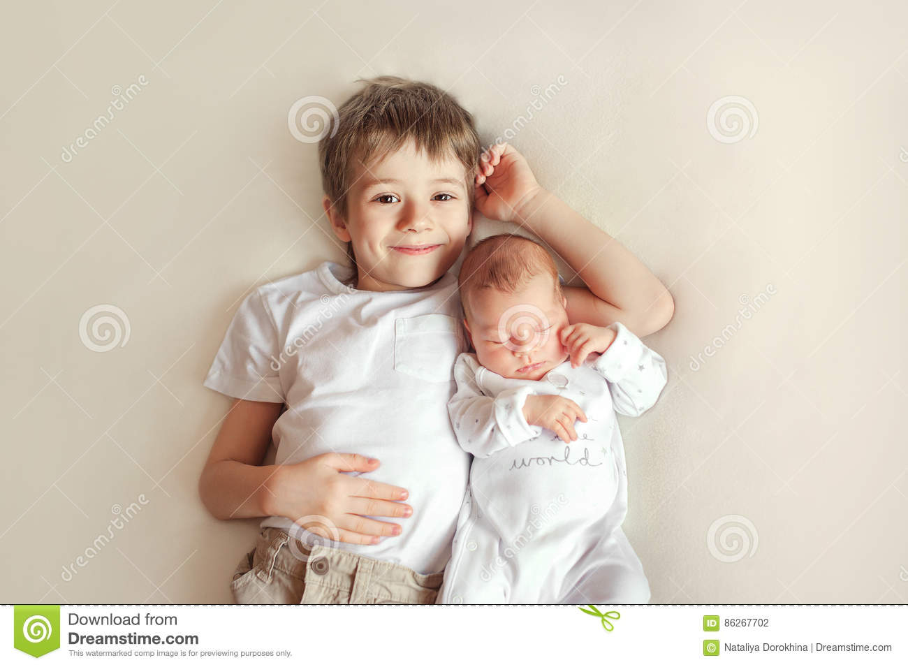 0fd3afeac6b3 Little Brother Hugging Her Newborn Baby. Toddler Kid Meeting New ...