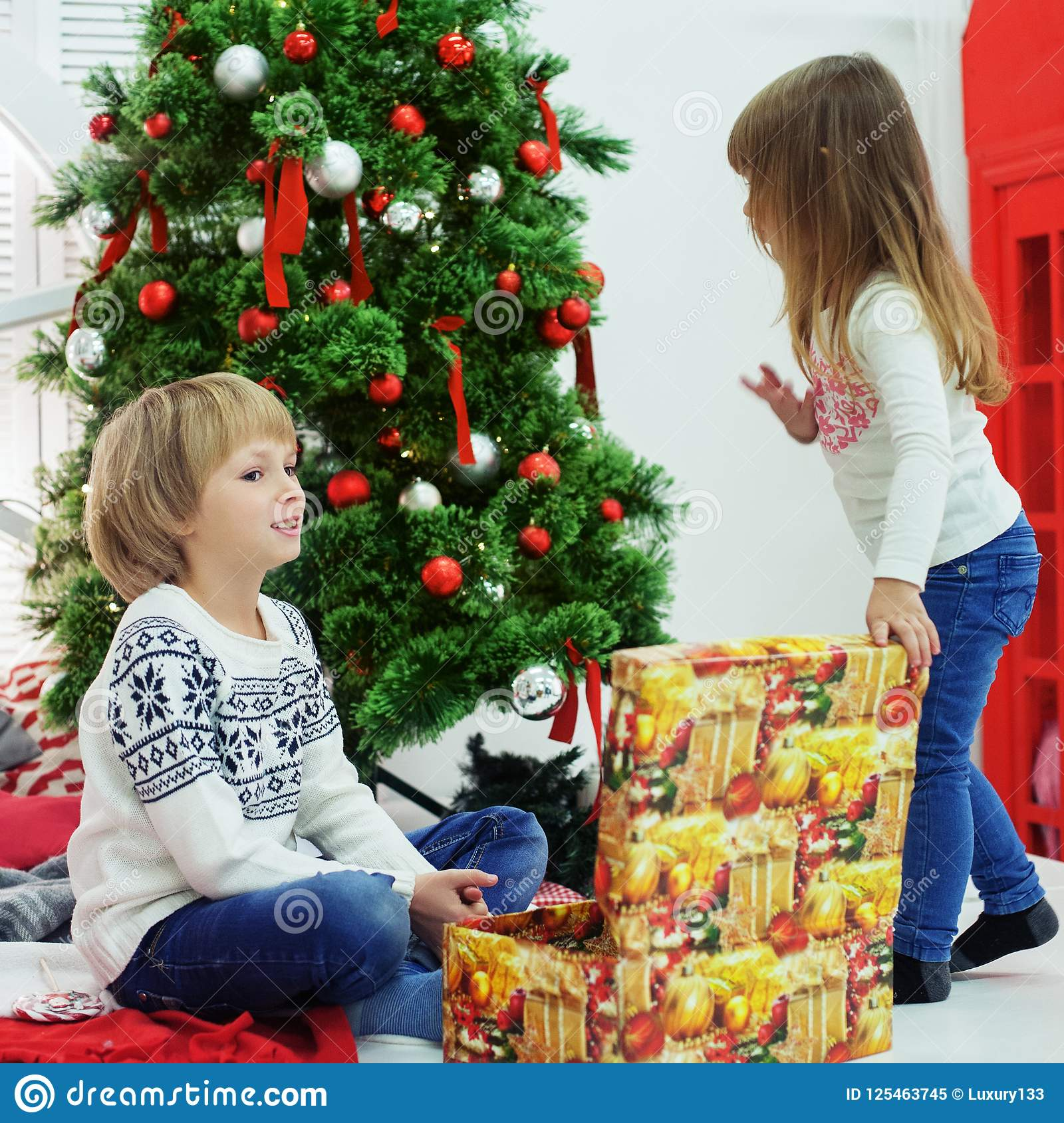 little brother and sister received gifts square the concept of christmas and new year
