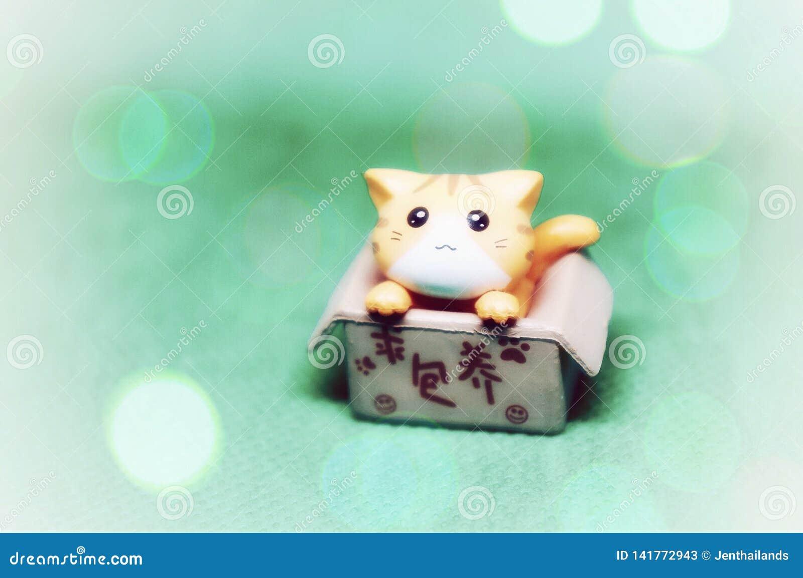 Little cute plastic cat in a box