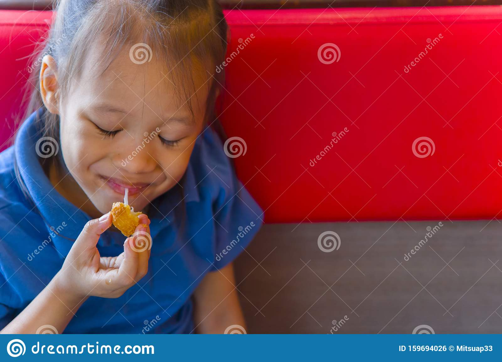 Little Child Asian Eating Sticky Stretch Fried Cheese Ball ...