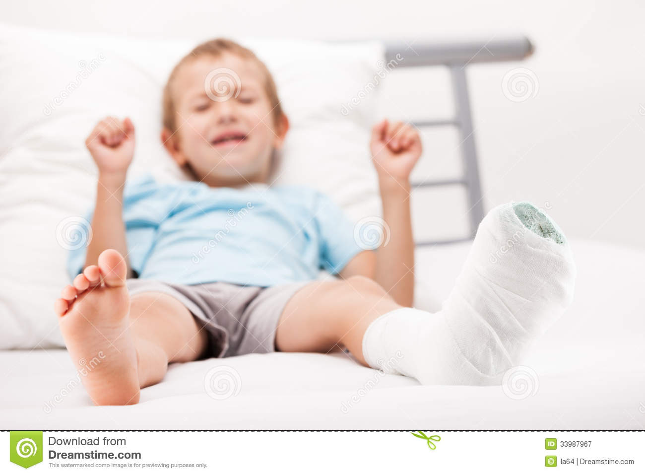 ... boy with plaster bandage on leg heel fracture or broken foot bone
