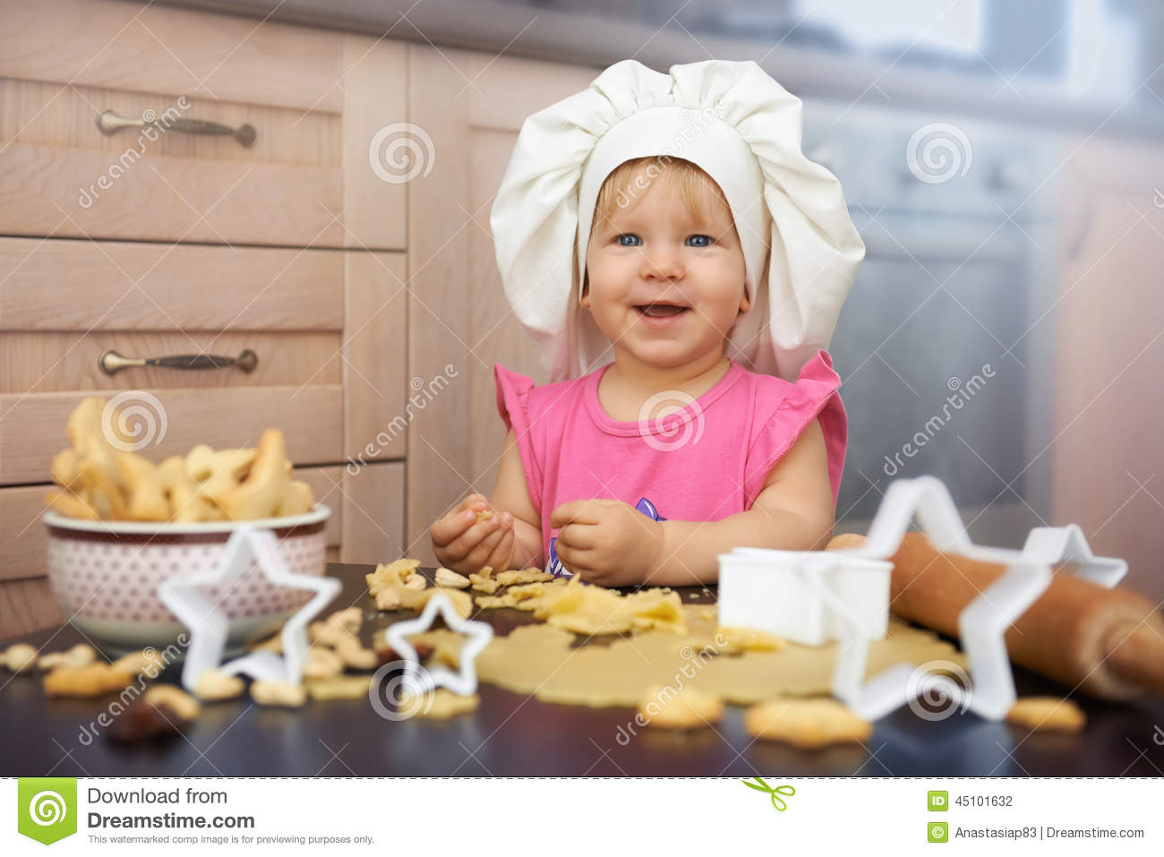 Little Child Chief Cooking Cookies In The Kitchen Stock