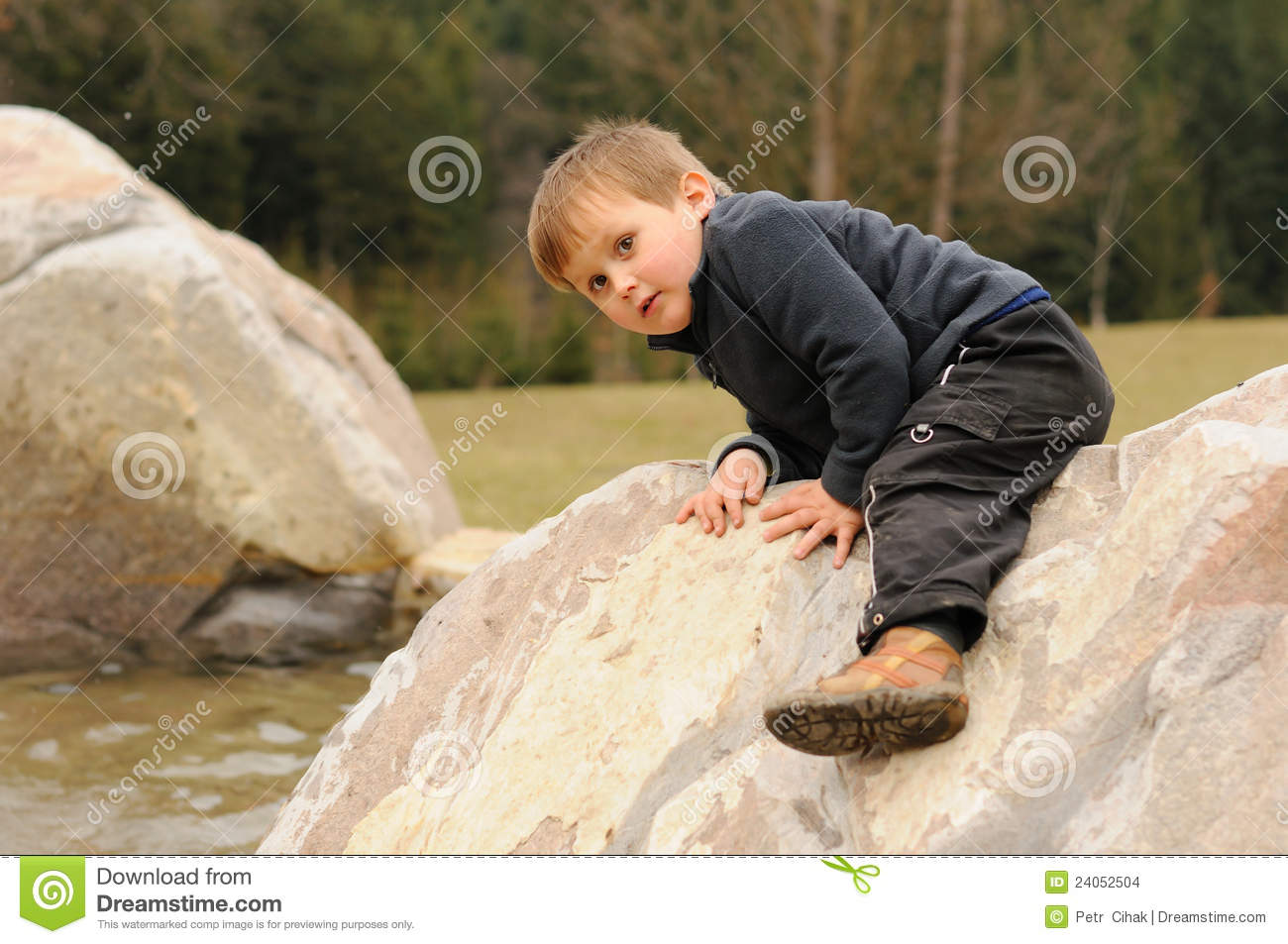 Elementary Classroom Themes ~ Little child climbing rock stock images image