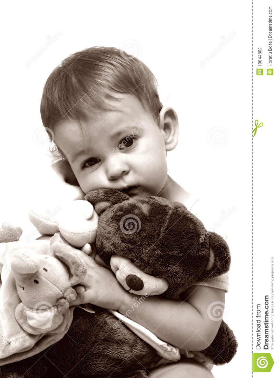 Little child and her teddy bear