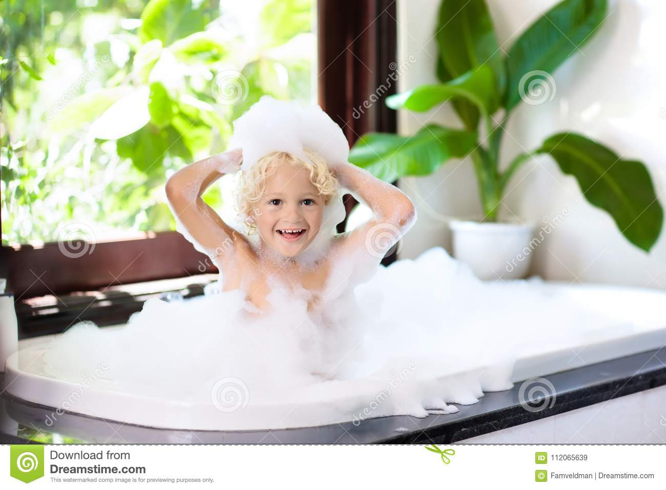 Child In Bubble Bath. Kid Bathing. Baby In Shower. Stock Image ...