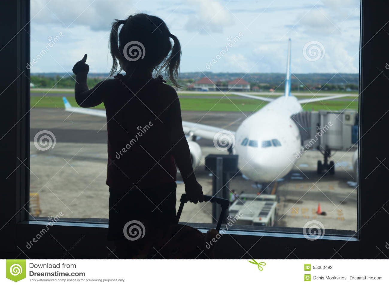 Little Child Waiting For Boarding To Flight In Airport