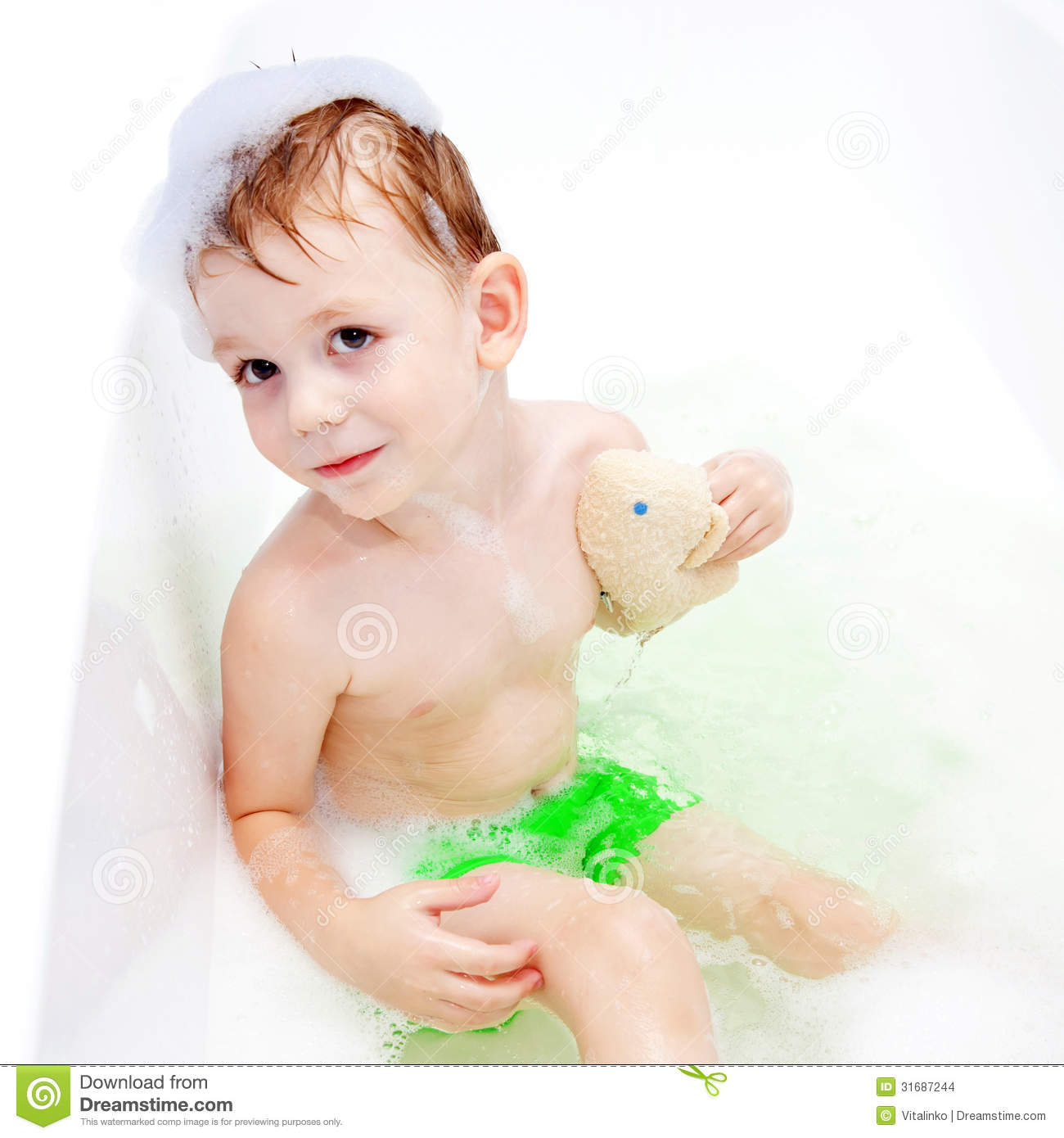 Little child washing his body with sponge stock images image