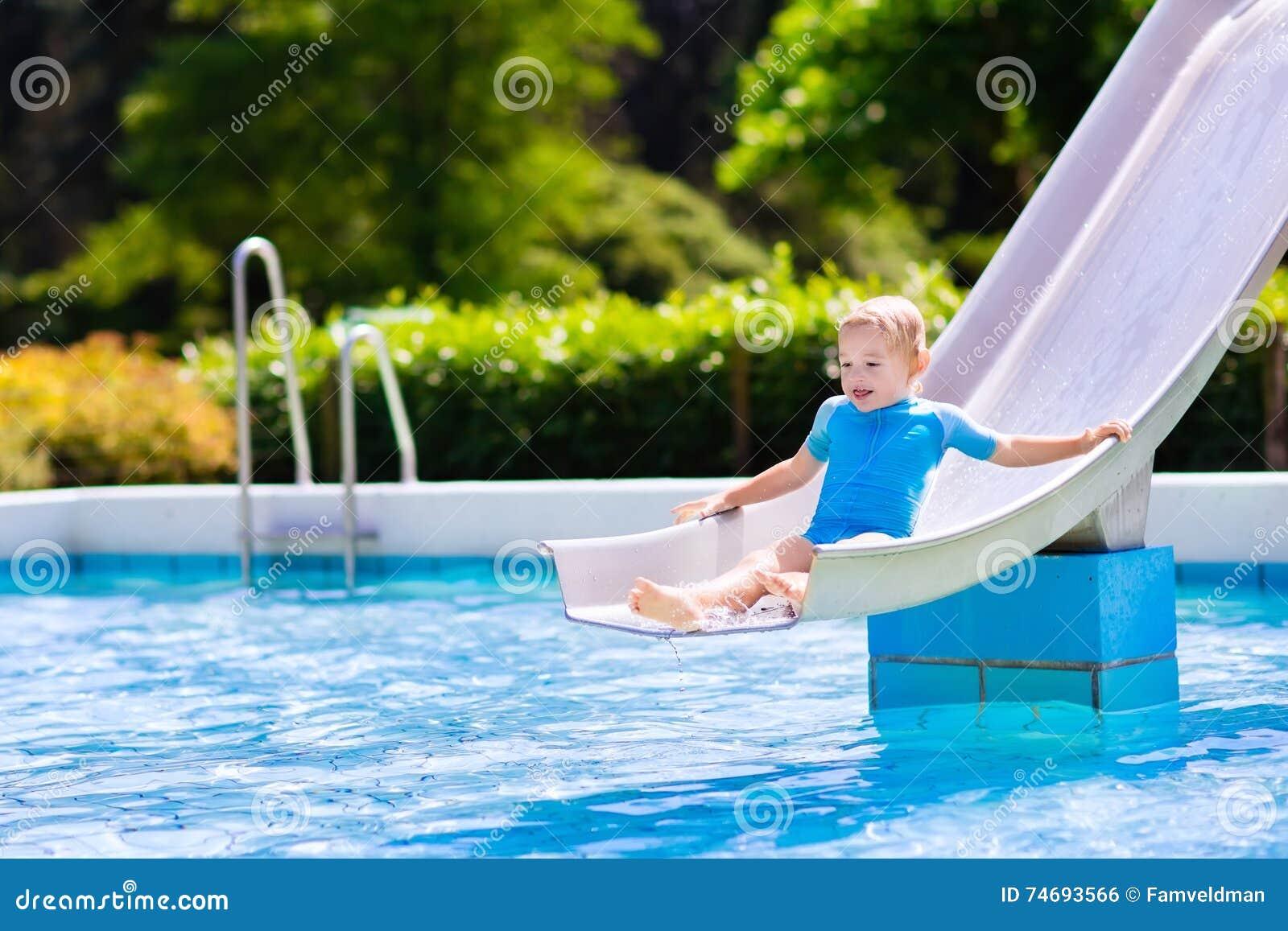 Kids On Water Slide In Swimming Pool Stock Photo 74693508
