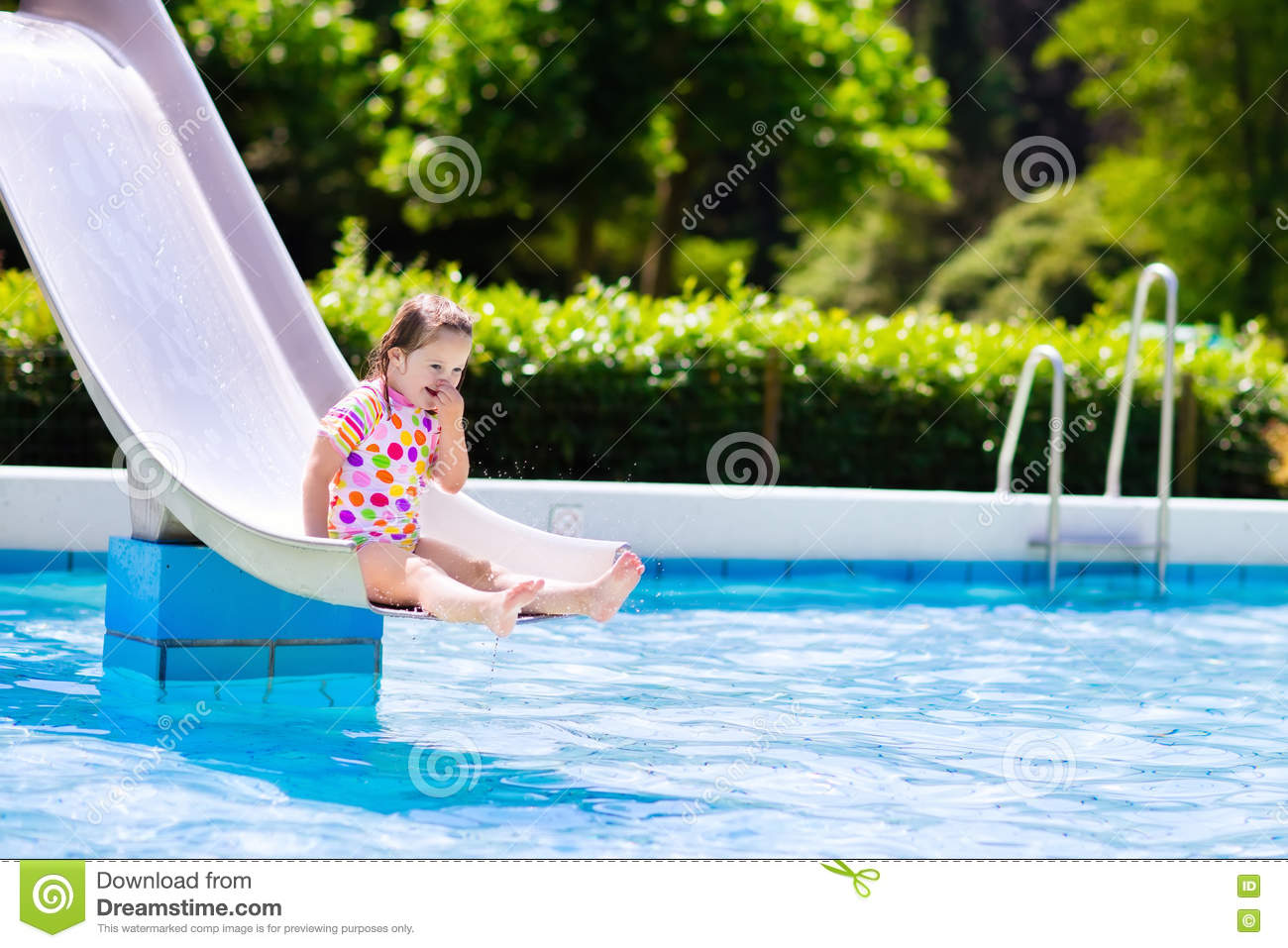 Kids On Water Slide In Swimming Pool Stock Photo