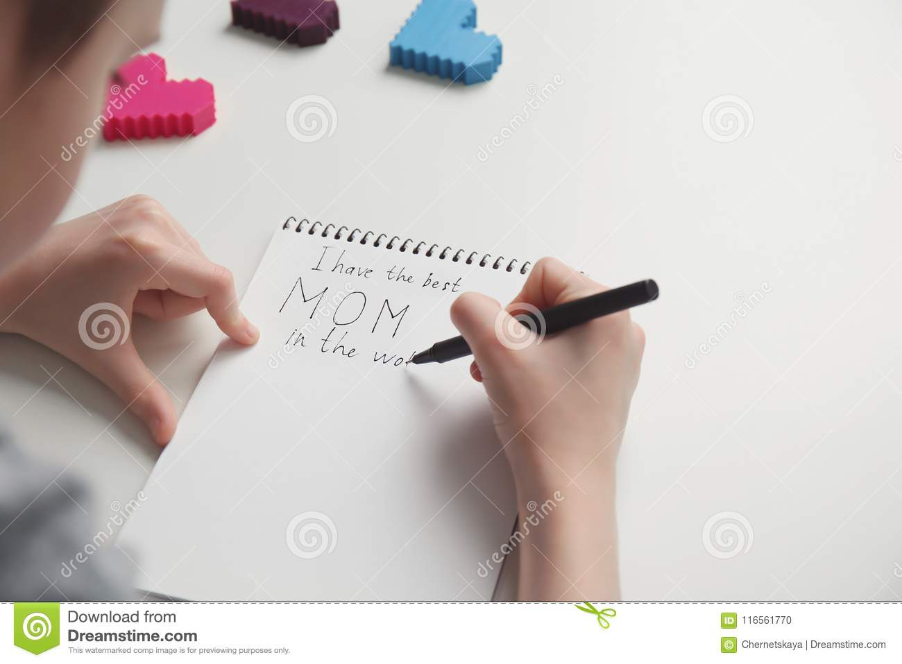Little Child Writing Congratulation For Mother`s Day Stock