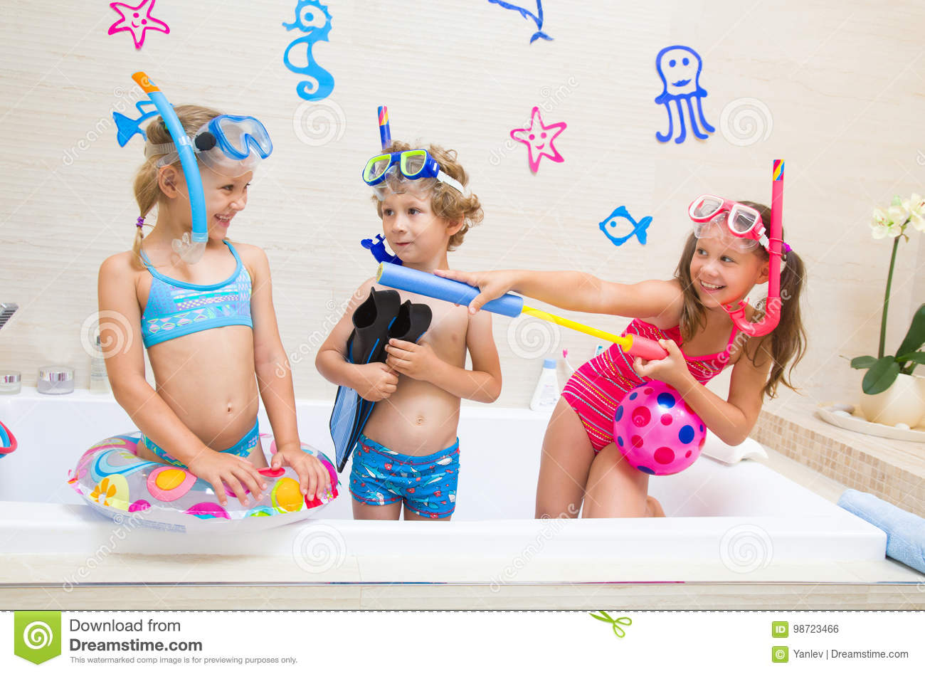 61670fff1a3d3 Children Play In The Bathroom Stock Photo - Image of fins, people ...